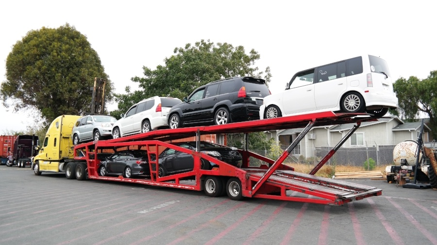 Cars being collected for shipping to Cambodia from USA