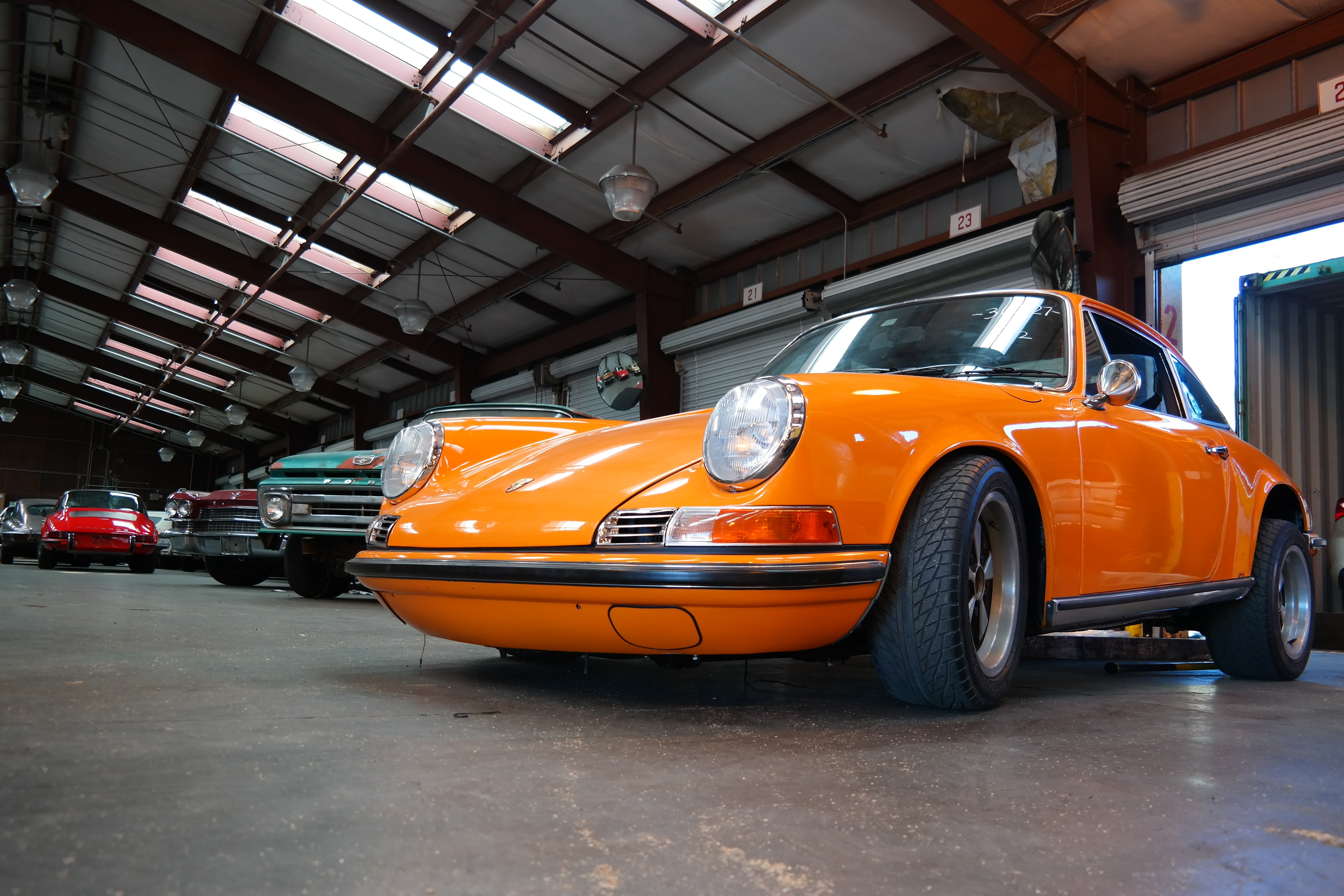 Classic cars waiting to be shipped overseas in a container